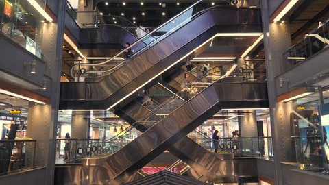 Tourists on Escalators in Siam Center Shopping Mall. Bangkok, Thailand - 18 NOV 2017.
