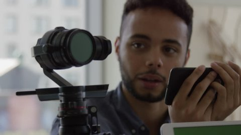 Robotic Articulating Gimbal Arm Controlled By African American Young Attractive Millenial Tech Engineer In Slow Motion