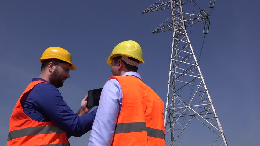 Engineering team electricians electricity engineers working tablet electric pole | Shutterstock HD Video #32978878