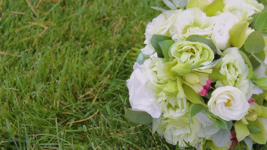 Beautiful wedding bouquets on the grass | Shutterstock HD Video #32993464