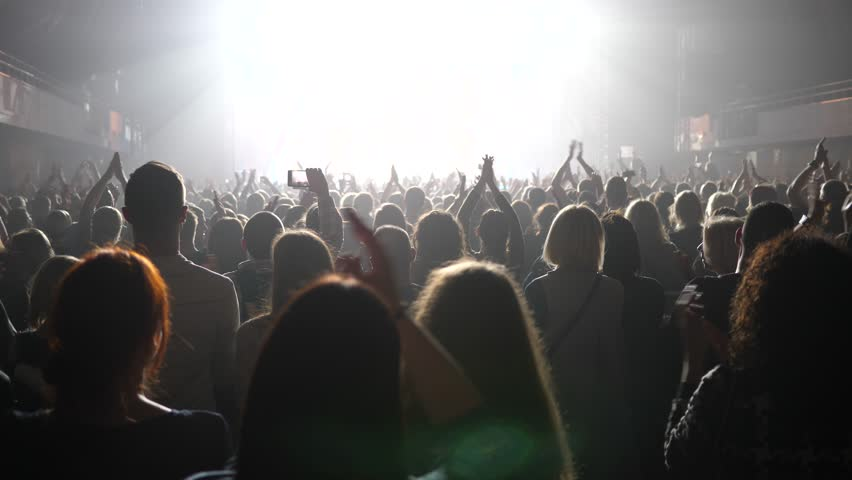 Clapping spectators - cheering concert crowd fan people in stage bright light lumiere | Shutterstock HD Video #33009658