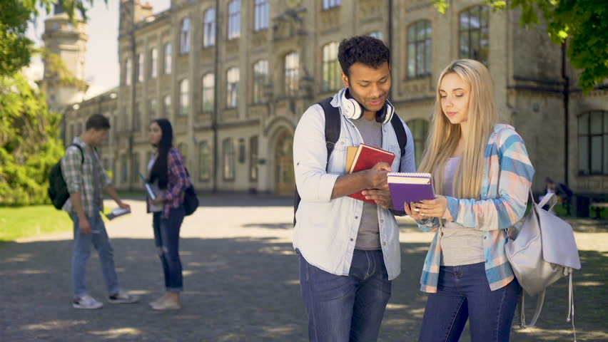 Classmates communicating on campus of university after classes, friendship | Shutterstock HD Video #33020557