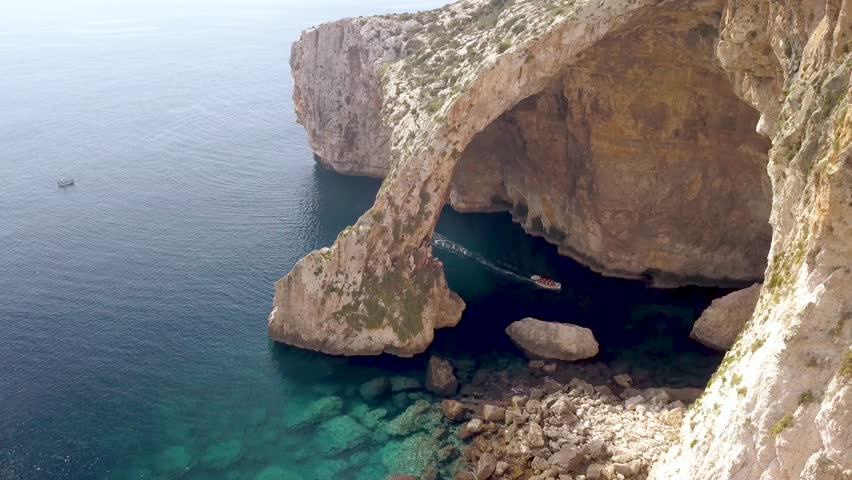 Blue grotto in Malta, aerial view of the arch with green water.