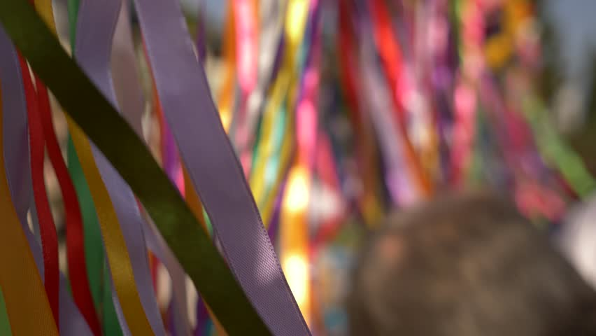 close-up of the wind flaps of a garland of colorful ribbons. Copy space 4k