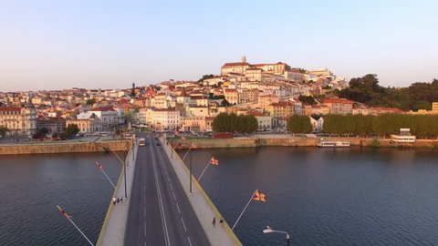 Coimbra, Portugal, aerial view of cityscape including the famous University of Coimbra and Mondego river at sunset.