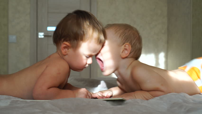 Two small children (brothers) quarrel with each other | Shutterstock HD Video #33047419