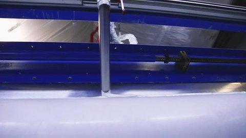 production linoleum. application of PVC-layer on the linoleum