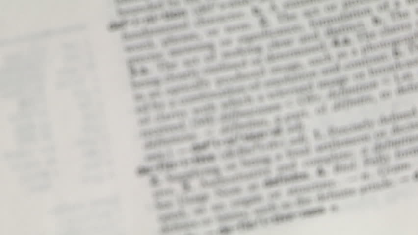 Magnifying glass focuses on the word definition in a dictionary | Shutterstock HD Video #330748