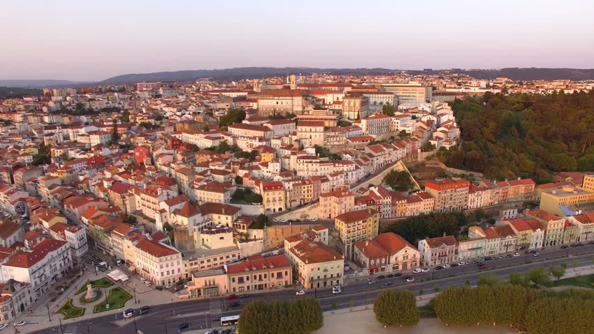 Coimbra, Portugal, aerial view of cityscape including the University of Coimbra and Clock Tower at sunset. | Shutterstock HD Video #33081118