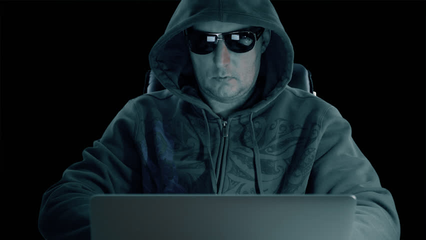 Hacker use mobile phone. Adult man in hood and glasses sits at laptop dark night. Man use smartphone. Modern technology. Alpha channel chroma key transparent background. | Shutterstock HD Video #33082861