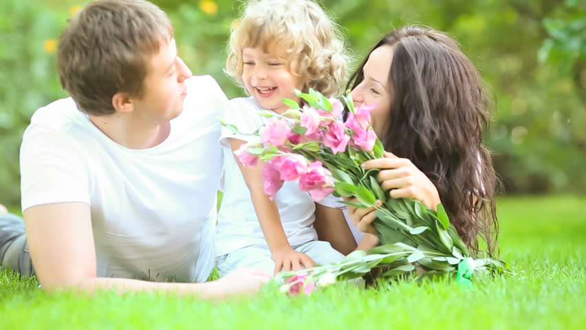 Happy family having fun outdoors in spring park | Shutterstock HD Video #3309638