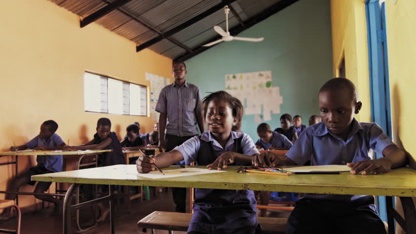 4k of African teacher giving assistance to pupil / students in drawing art class. | Shutterstock HD Video #33097138