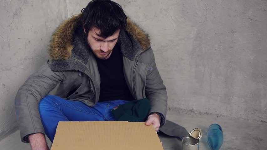 unemployment homeless designer sittin on the floor and asking for help
