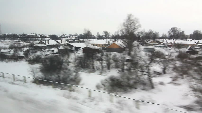 View from window of high-speed train Sapsan at the village, meandering river in the winter (High angle) POV