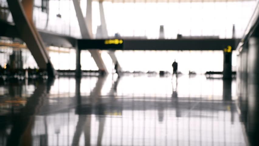 Defocused airport baackground. Silhouette people walking at the airport. | Shutterstock HD Video #33111670