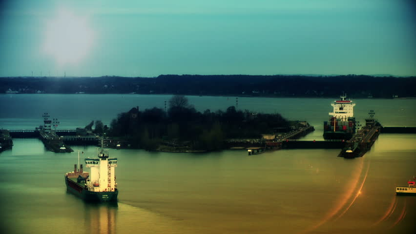 Cargo ships at sunset passing Kiel Cannal, Germany