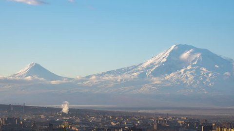 Time lapse of Yerevan city and snow-capped mount Ararat with panning in the morning
