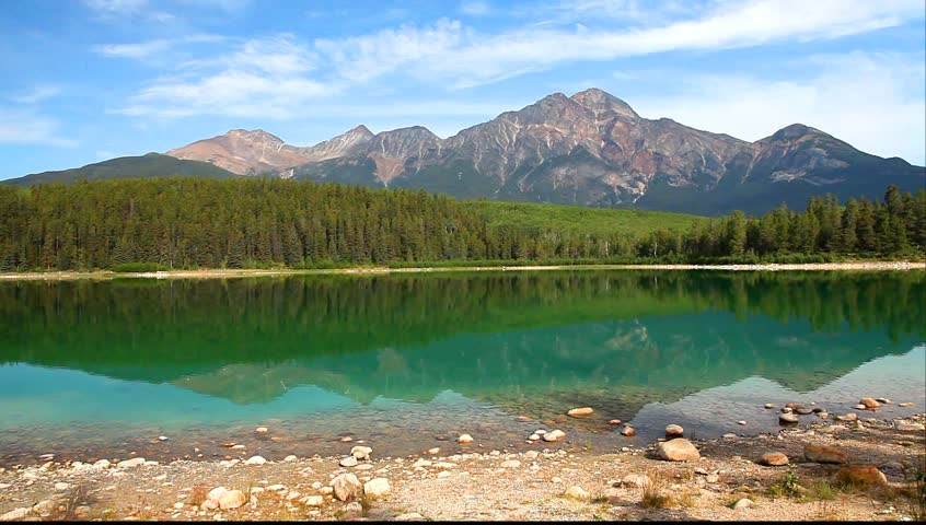 Mountain lake with reflection on the smooth water. (Patricia lake and Pyramid Mountain) in Jasper National Park, Canada