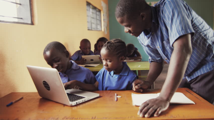4k of teacher instructing African school students / pupils to use laptop computer in classroom. | Shutterstock HD Video #33160741