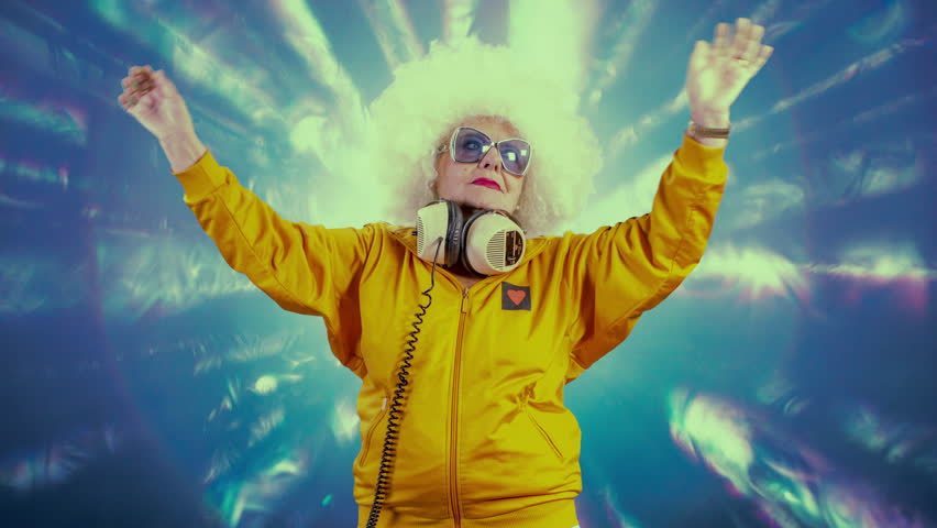The most amazing grandma you will ever meet as a disco dancer, older lady partying in a hypnotic colourful disco setting | Shutterstock HD Video #33160978
