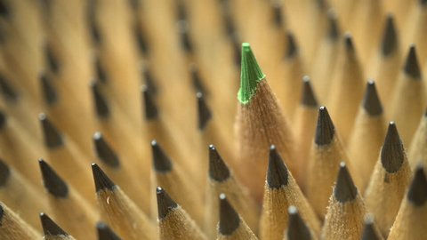 Uniform geometrical group of graphic pencils with green one in focus