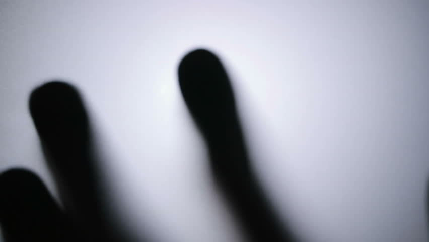 Palm through the frosted glass. Horror video. | Shutterstock HD Video #33174418