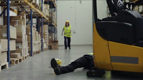 An injured worker after an accident in a warehouse.