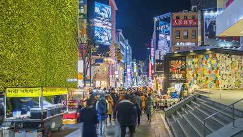 SEOUL, SOUTH KOREA - NOVEMBER 26, 2017 : Timelapse at Myeong-dong Market.People walking on a shopping street at night, Seoul, South Korea