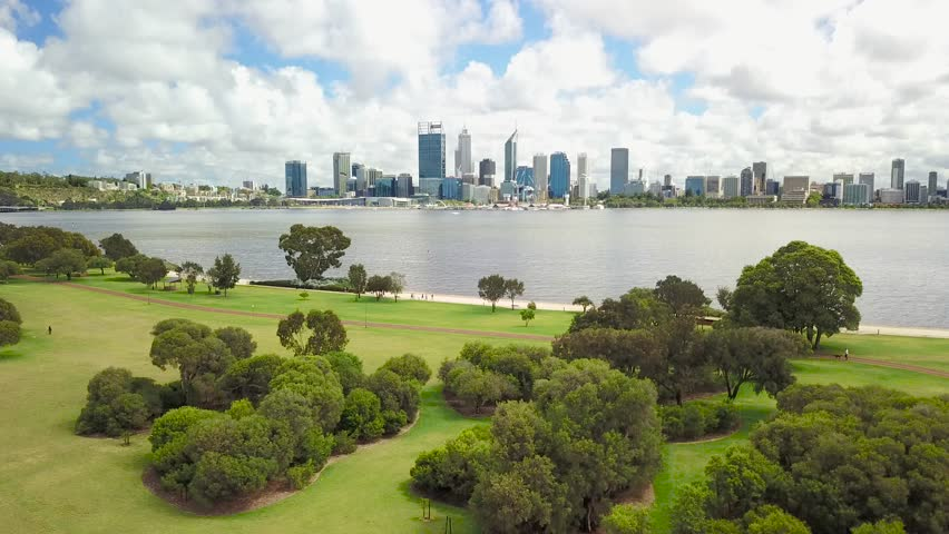 Aerial footage over Sir James Mitchell Park in South Perth with the Perth city skyline visible in the distance. Western Australia.