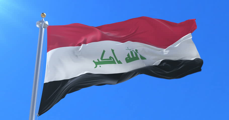 Flag of Iraq waving at wind in slow in blue sky, loop