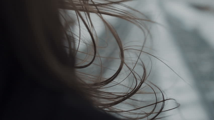 Hair movement in wind closeup. Close up woman with dark hair. Winter fashion concept.