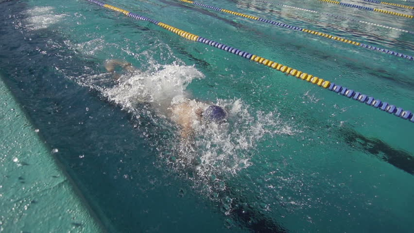 Professional Swimmer Training The Butterfly Stroke. Close Shot In Slow Motion.