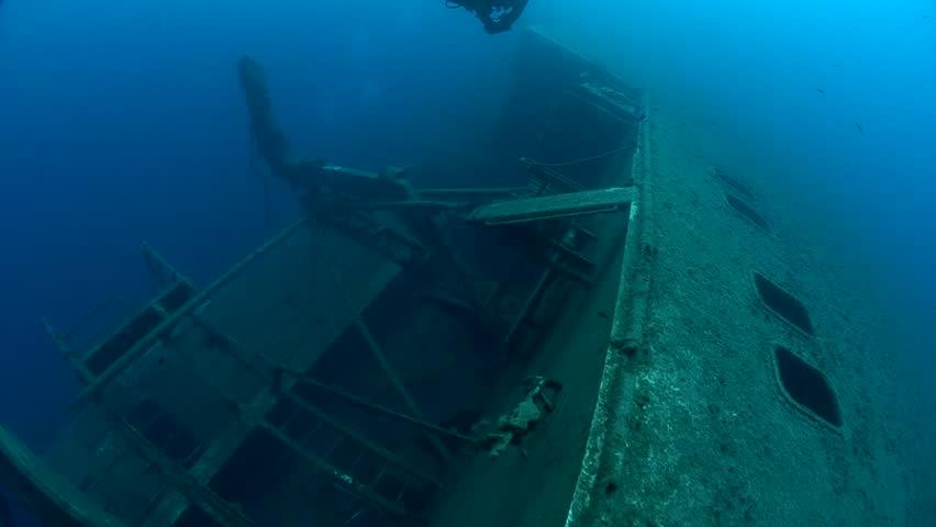 SCUBA divers exploring underwater wreck Zenobia   Shutterstock HD Video #33347983