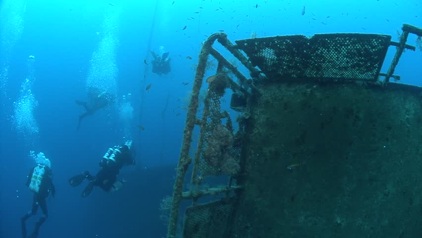 SCUBA divers exploring underwater wreck Zenobia | Shutterstock HD Video #33347998