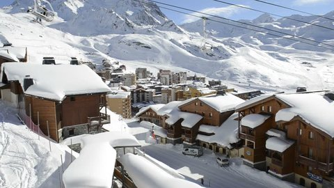 VAL THORENS, JANUARY 22 - View on the town of Val Thorens in the French Alps. People sitting in a ski lift are going up the mountain.