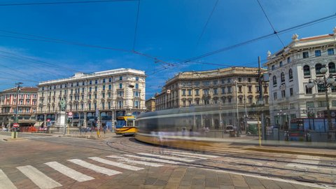 Cordusio Square and Dante street with surrounding palaces, houses and buildings timelapse hyperlapse in Italian capital of fashion and luxury. Trams passing by. Monument to writer and poet Giuseppe