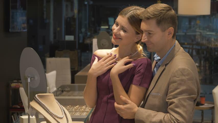 A girl is in a jewelry store. | Shutterstock HD Video #33413038