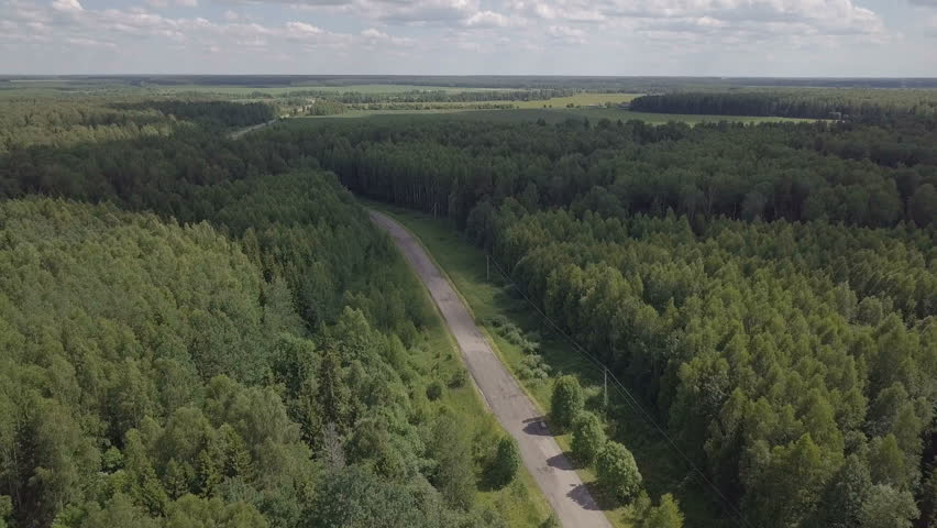 Empty road in the woods. Flight up over river. Aerial landscape. Small river, trees and fields. Earth without humanity. | Shutterstock HD Video #33463348