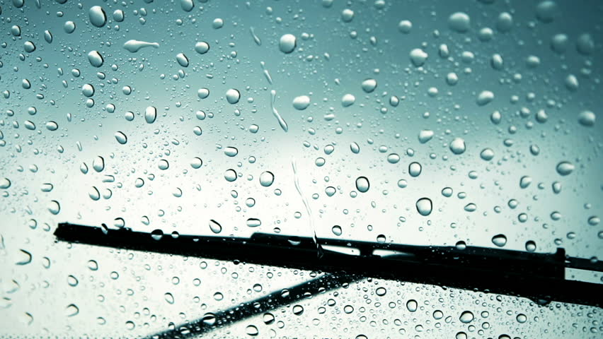 Windshield wiper with rain drops after storm on the dramatic sky background | Shutterstock HD Video #33486538