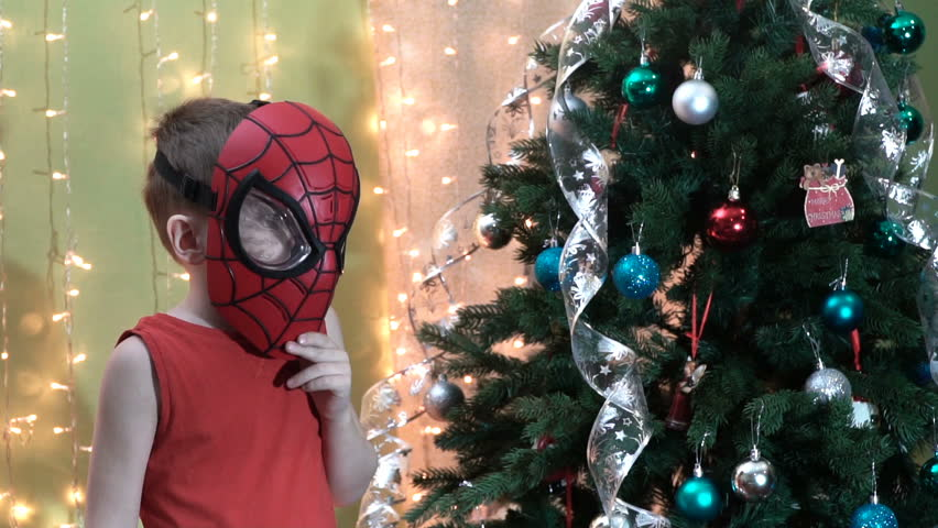 Samara, Russia - November 16,2017 ; The boy in Spiderman mask near Christmas tree.Spiderman is a popular charactel Marvel.