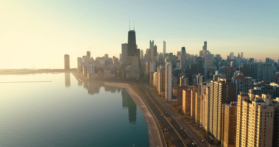 Aerial shot of Chicago Downtown skyline at sunrise. Buildings by the lake shore with road and cars | Shutterstock HD Video #33539878