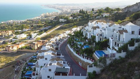 The landscape view of the beautiful village in Fuengirola Spain where seen the white houses fronting the blue sea