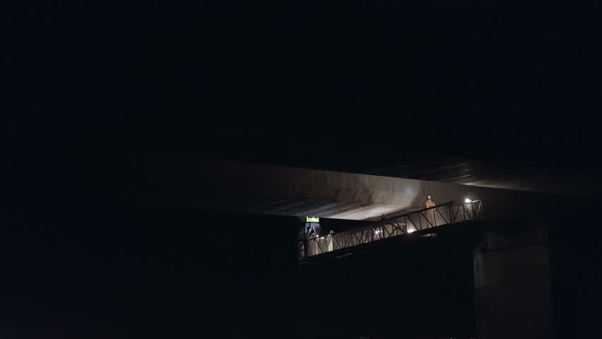 Bridge Inspection Team Surveying the Underside of a Concrete Bridge Taking Photos and Checking for Structural Damage