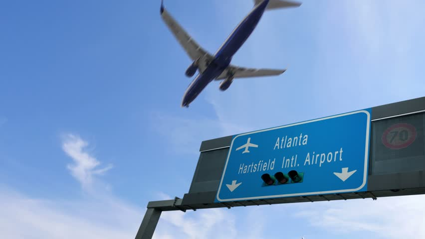 Airplane flying over atlanta airport signboard | Shutterstock HD Video #33578548
