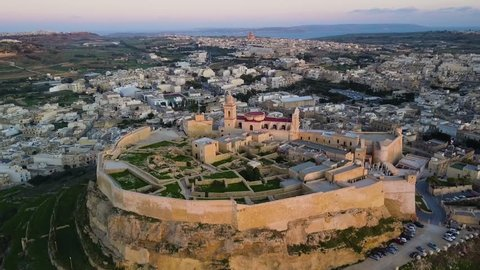 4k aerial drone footage - Sunset over the Gozo Citadel in Victoria (Rabat).   This ancient medieval castle is located on the island of Gozo, Malta.