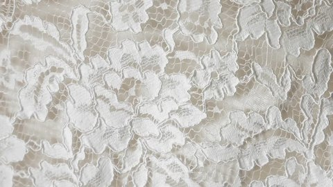 intricate lace wedding dress  closeup panning