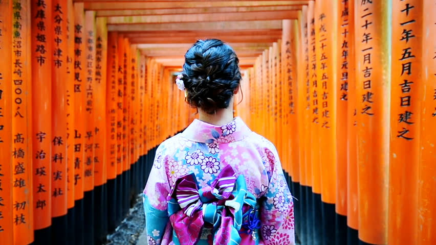 Asian women in traditional japanese kimonos walking at Fushimi Inari Shrine in Kyoto, Japan. | Shutterstock HD Video #33639808