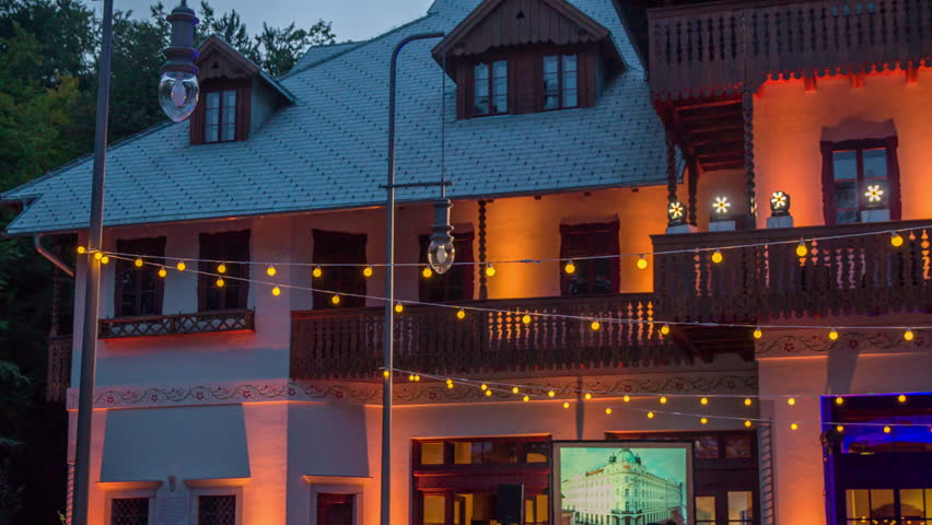 MICE LJUBLJANA, SLOVENIA - CIRCA AUGUST 2017 Old gracious villa decorated with yellow fairy-lights | Shutterstock HD Video #33640078