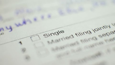 Pen and checkbox in blank tax form. Focus on single status