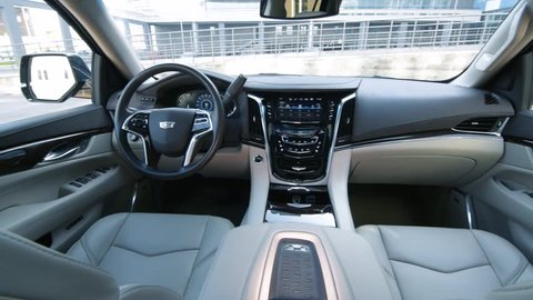 MINSK, BELARUS - AUGUST 27, 2017: Remarkably elegant interior of Cadillac Escalade 6.2 V8. Interior features light beige leather trim, first-rate materials and top-notch construction.